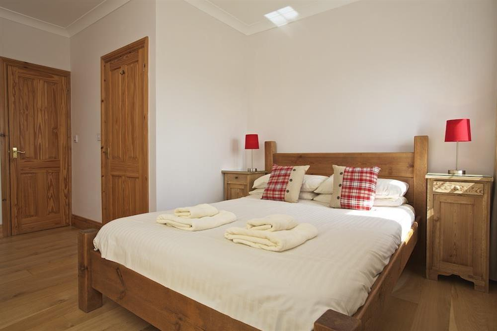 Master ensuite bedroom with King size pine bed at Southview in Blackawton, Nr Dartmouth