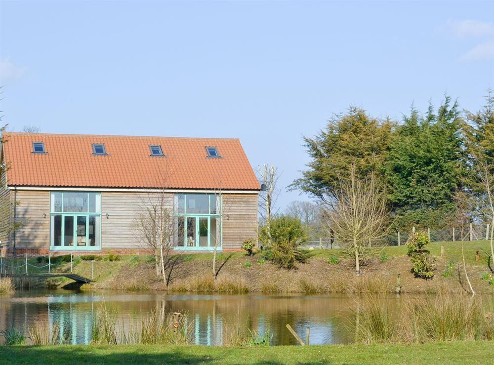 Attractive waterfront holiday lodges at Orchid Lodge,
