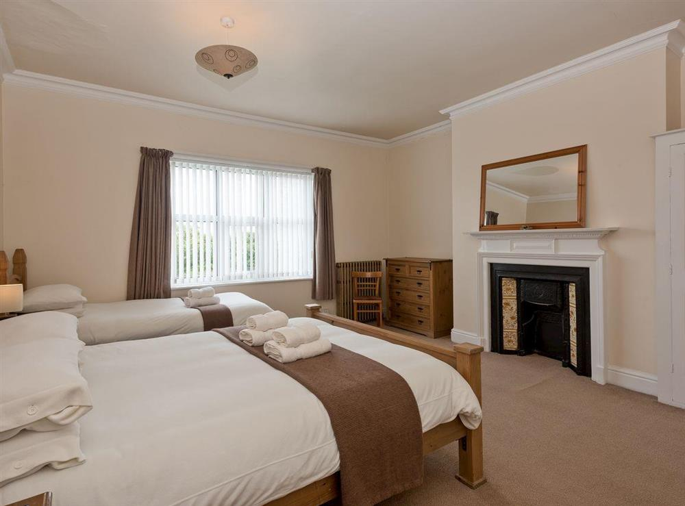 Triple bedroom at St. Peters Court in Bacton, Norfolk