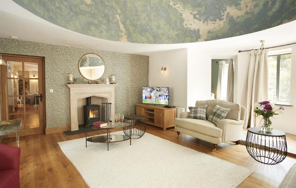 Ground floor: The grand and stately sitting room with an attractive domed ceiling