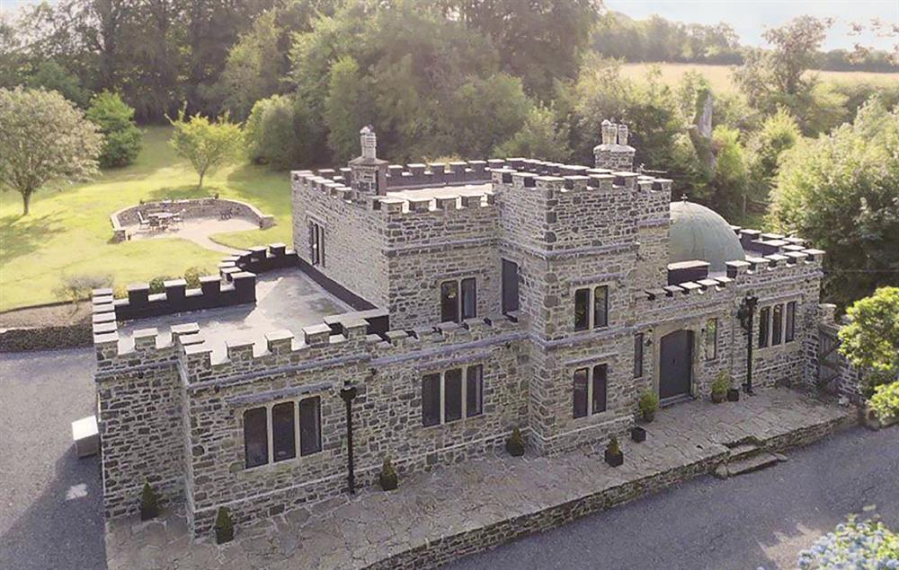 This luxury holiday home makes an instant and lasting impression, with crenelated stone walls and a copper dome
