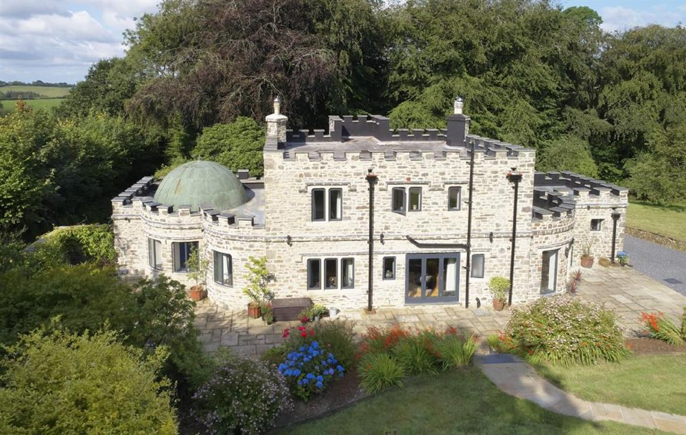 This special holiday home makes an instant and lasting impression, with crenelated stone walls and a copper dome