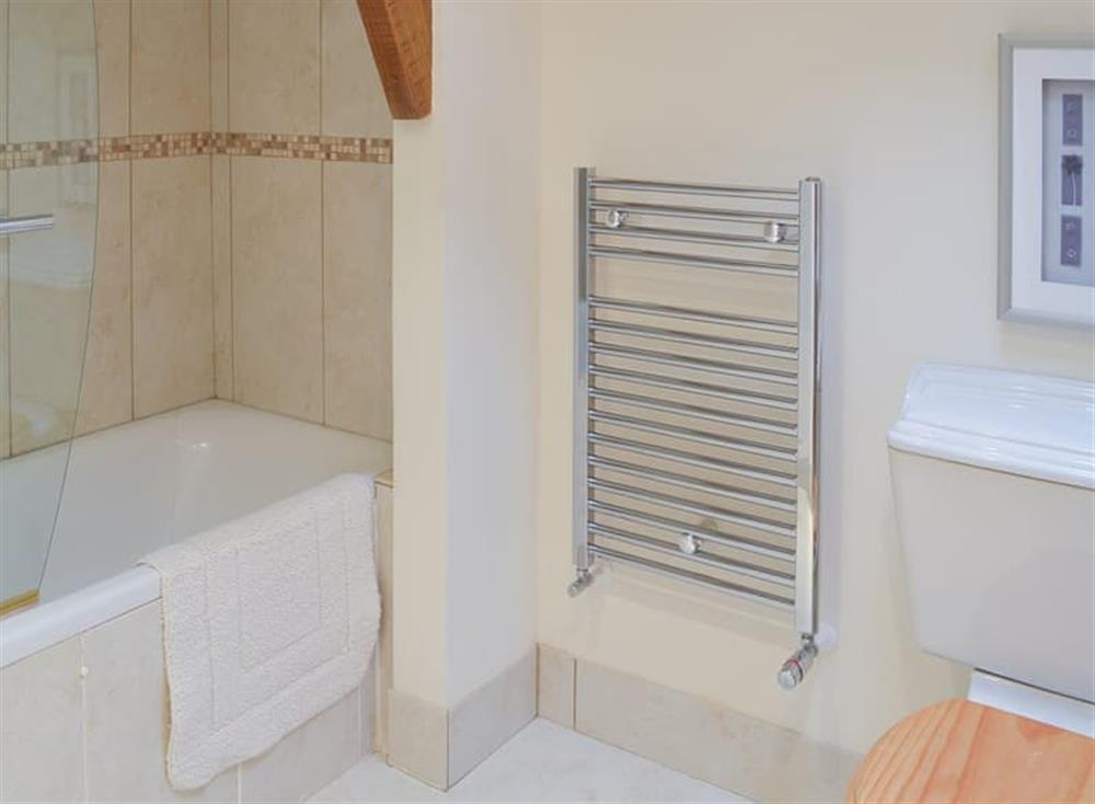Bathroom with shower over the bath at Stable Barn in Hendham, near Kingsbridge, Devon