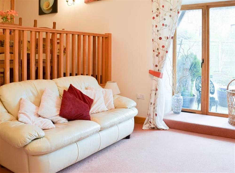 Homely living area with galleried dining area at Stable Barn in Hendham, near Kingsbridge, Devon