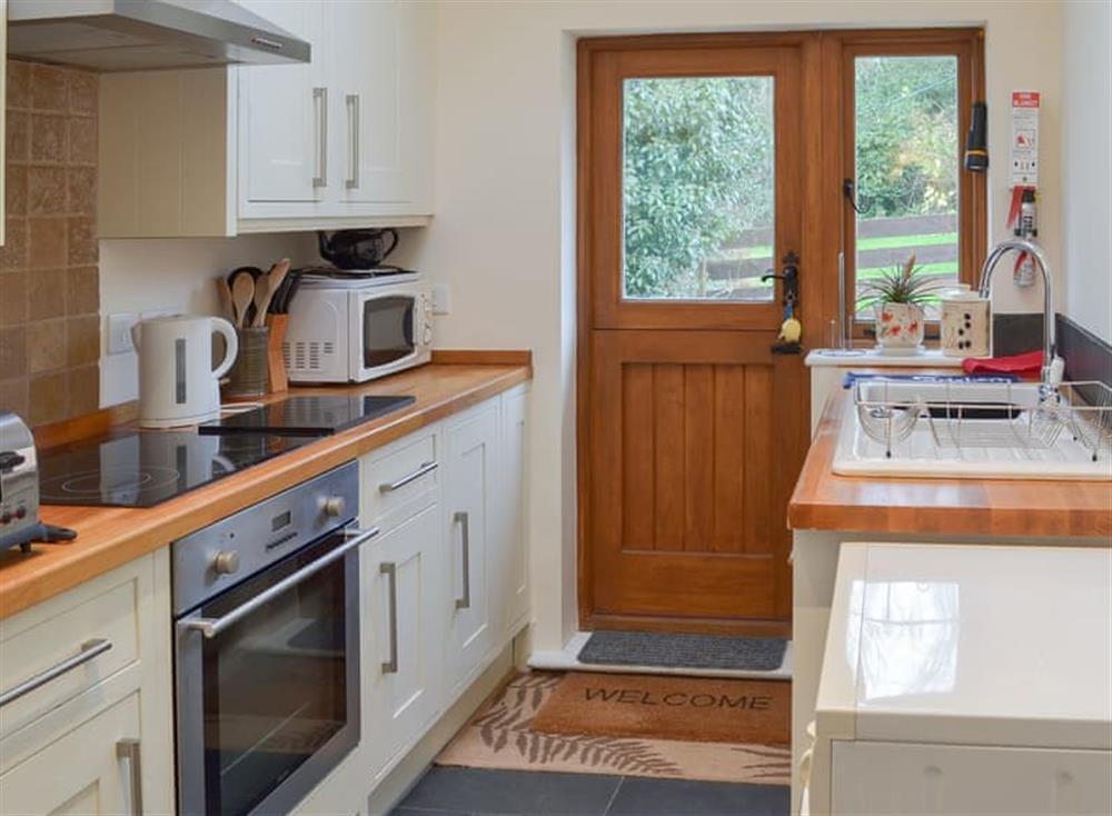 Kitchen with garden access at Stable Barn in Hendham, near Kingsbridge, Devon