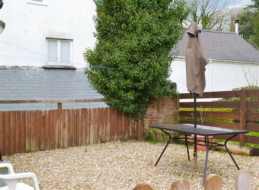 Private gravelled outdoor area with seating at Stable Barn in Hendham, near Kingsbridge, Devon