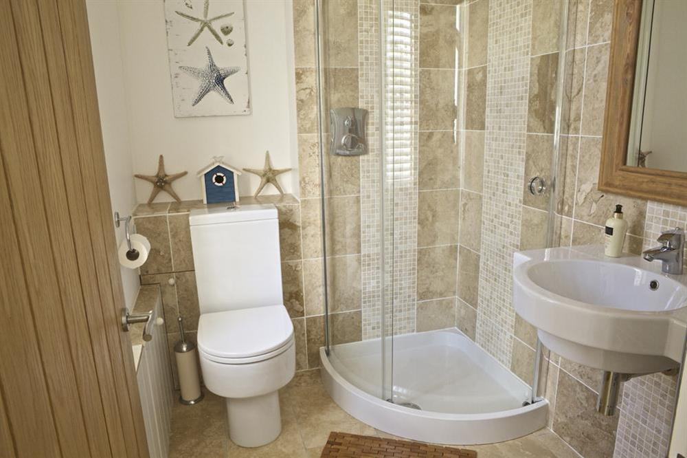 En suite shower room at Starfish Cottage in 40 Crowthers Hill, Dartmouth