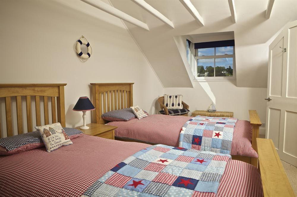 Twin room with two wooden framed single beds at Starfish Cottage in 40 Crowthers Hill, Dartmouth