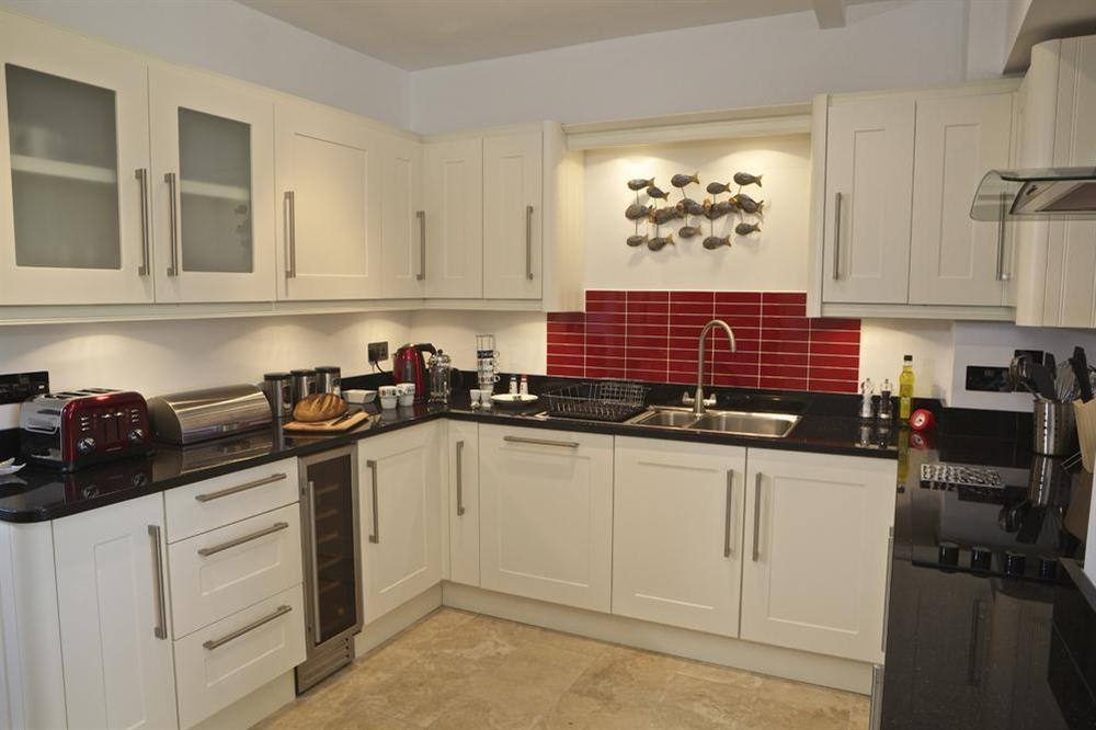 Well equipped kitchen at Starfish Cottage in 40 Crowthers Hill, Dartmouth
