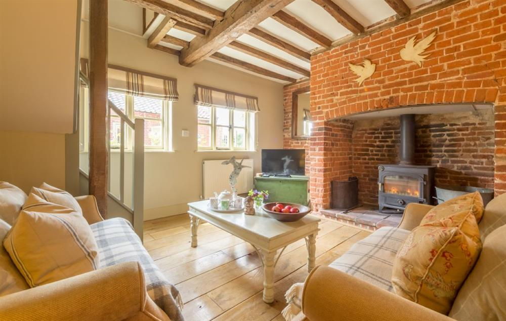 Ground floor: Sitting room with an inglenook fireplace with wood burning stove