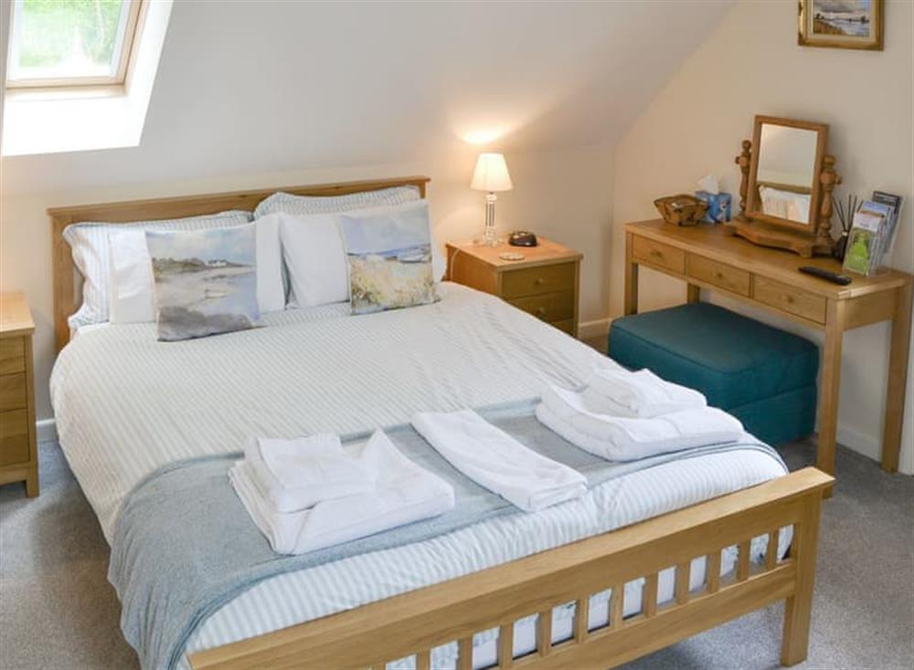 Relaxing double bed at Oak View Lodge,