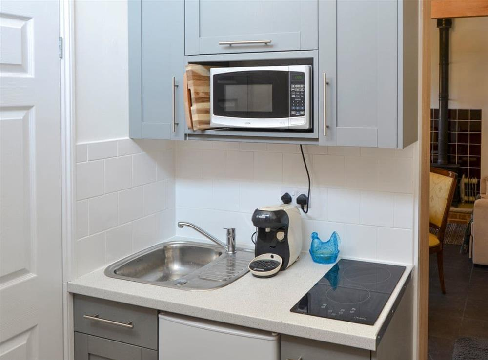 Compact kitchen area at The Old Stables,