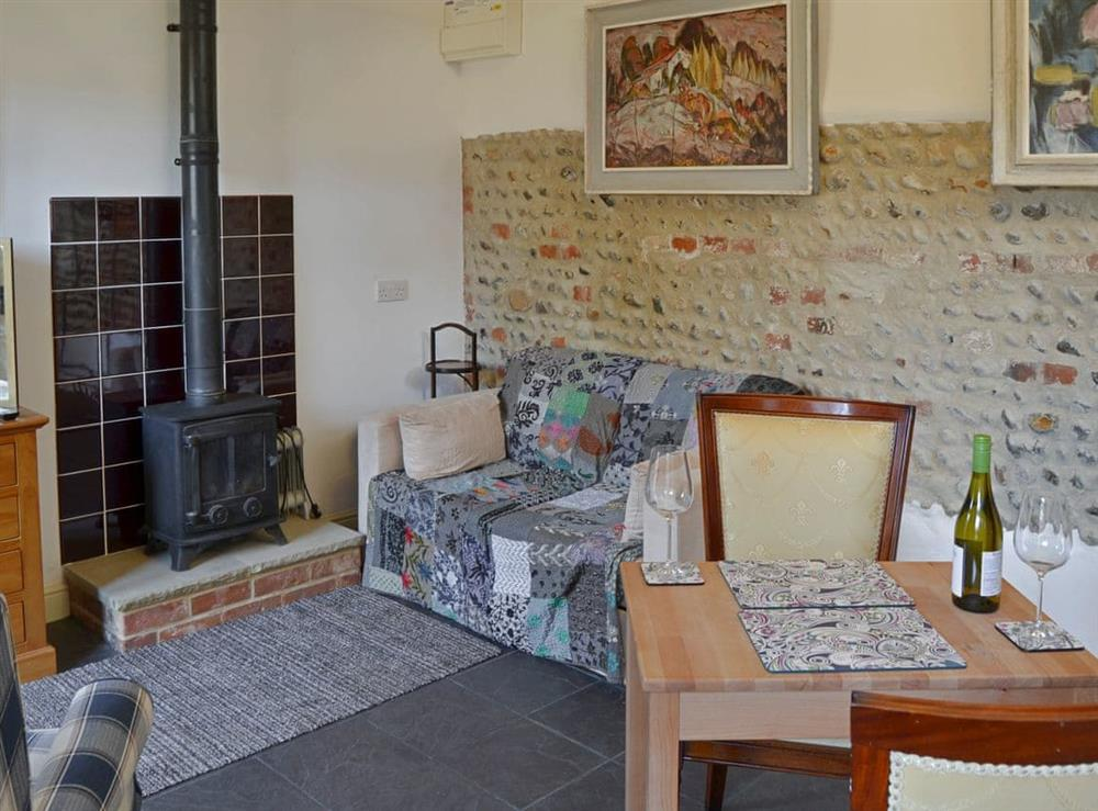 Cosy living area with wood burner at The Old Stables,