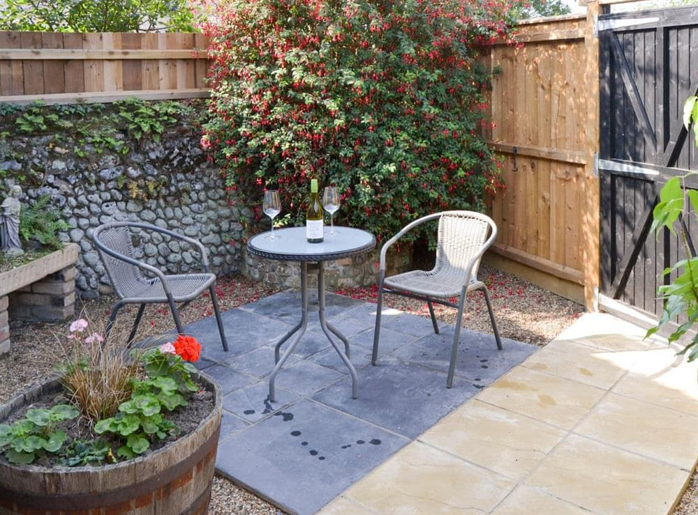Enclosed patio garden at The Old Stables,