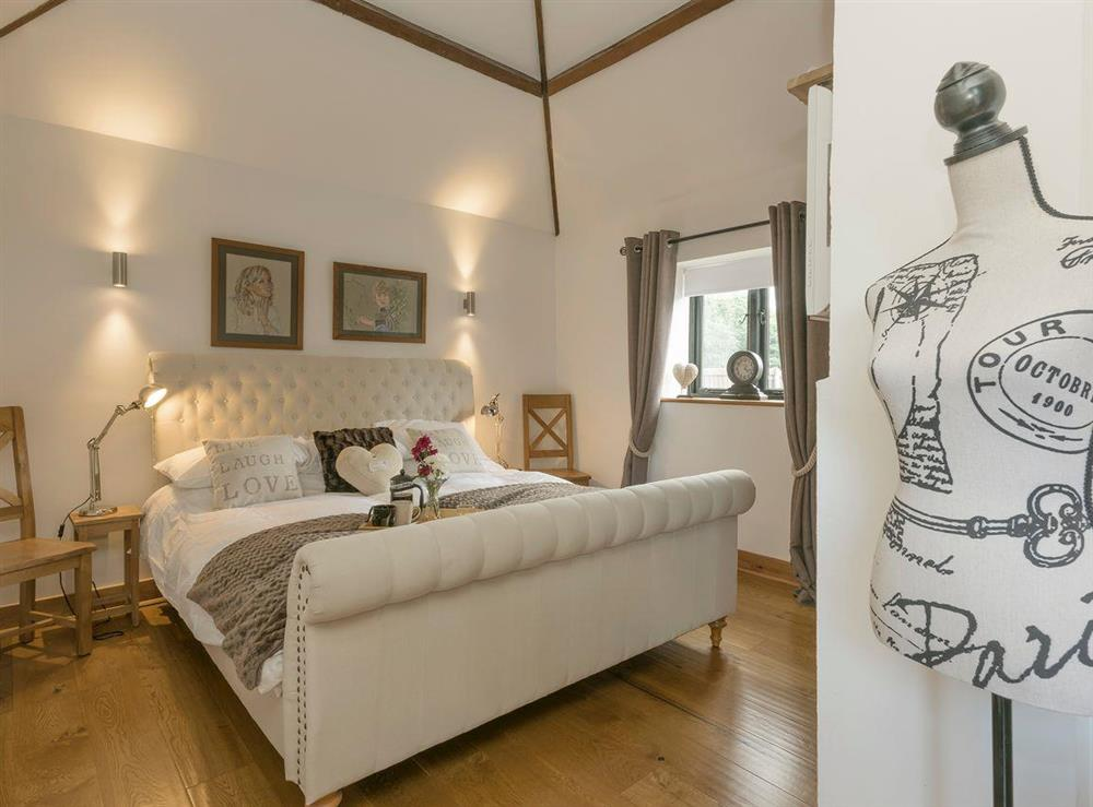 Beautiful master bedroom at Summer House Stables in Catfield, near Stalham, Norfolk