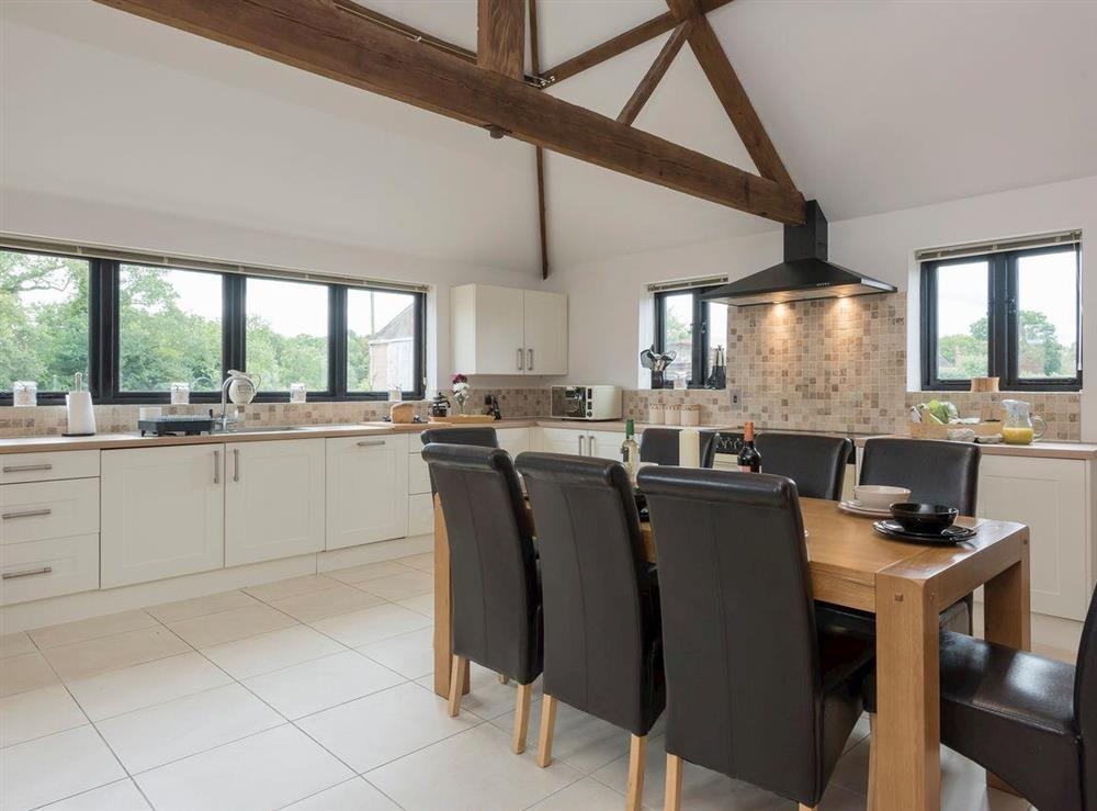 Convenient dining area within a well-equipped kitchen at Summer House Stables in Catfield, near Stalham, Norfolk