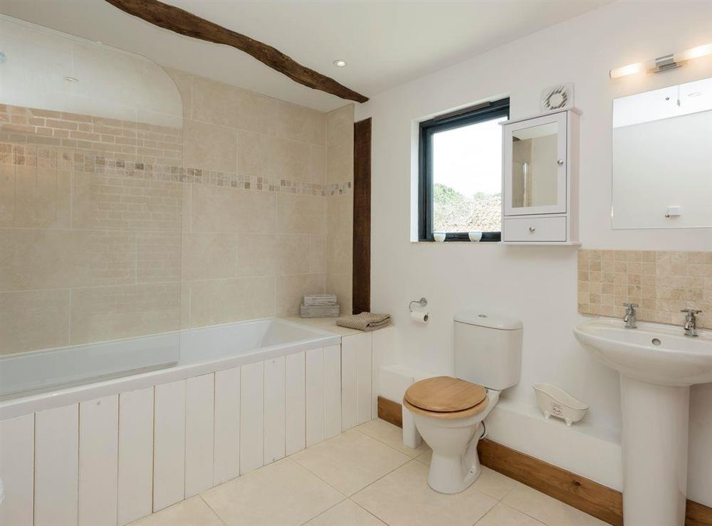 Family bathroom with shower over bath at Summer House Stables in Catfield, near Stalham, Norfolk