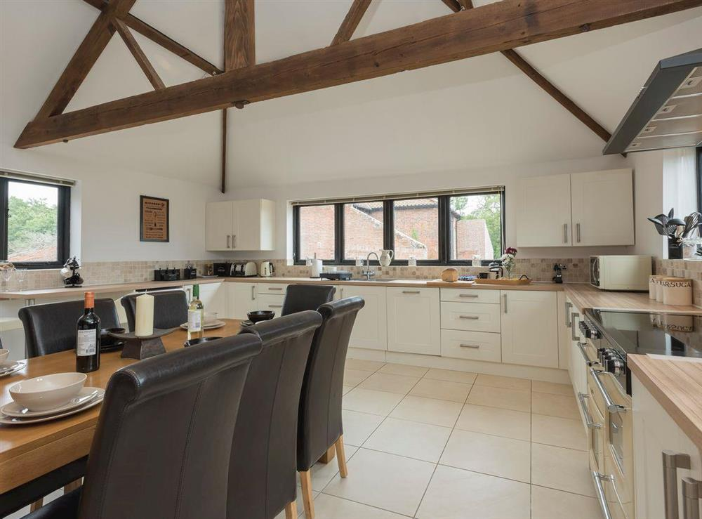 Large fully-appointed kitchen with dining area at Summer House Stables in Catfield, near Stalham, Norfolk