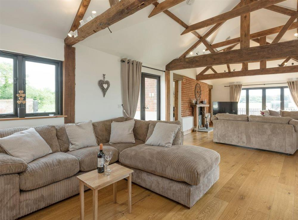 Spacious living areas with exposed beams throughout at Summer House Stables in Catfield, near Stalham, Norfolk