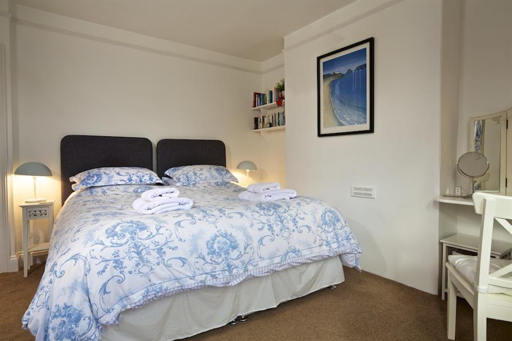 Master bedroom with King-size bed and window seat (photo 2) at Sunnyside in , Dartmouth