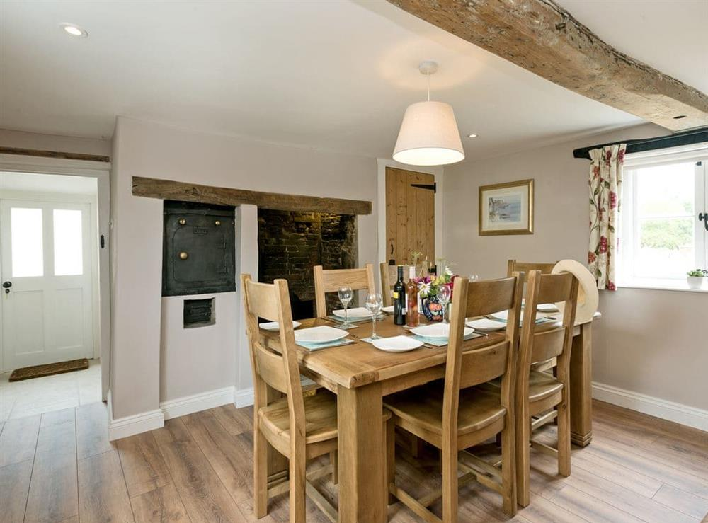 Characterful dining room with beams (photo 3) at Sunnyside in Ludham, near Wroxham, Norfolk