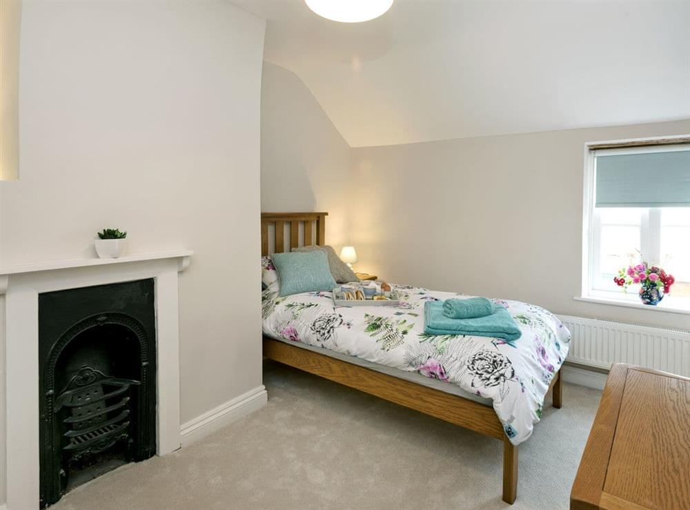 Comfortable twin bedroom with feature fireplace at Sunnyside in Ludham, near Wroxham, Norfolk