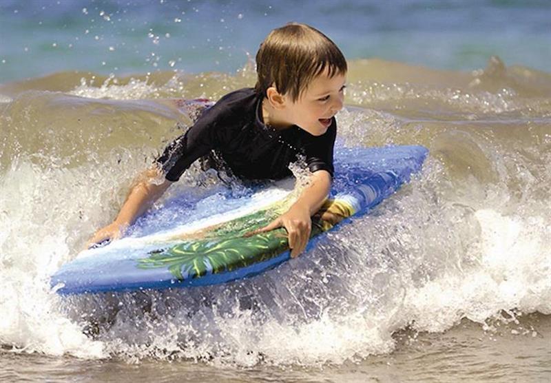 Surfing at Westward Ho! at Surf Bay Holiday Park in Westward Ho!, Devon