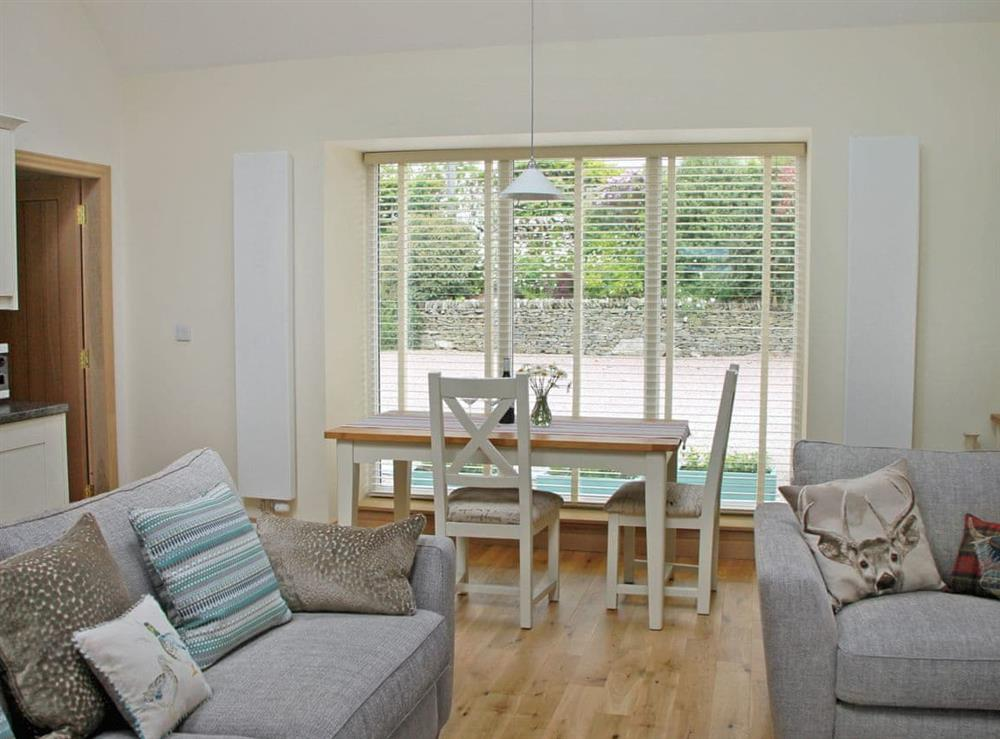 Welcoming living room/dining room at Swallows in Borgue, near Kirkcudbright, Kirkcudbrightshire