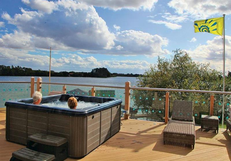 Shared outdoor spa hot tub at Tattershall Lakes Country Park in Tattershall, Lincolnshire