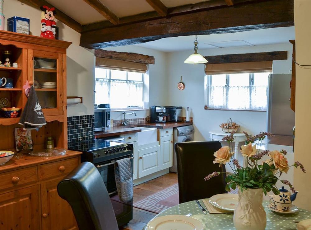 Beamed kitchen with breakfast area at Tattlepot Farmhouse in Pulham Market, near Diss, Norfolk