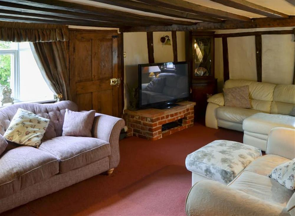 Beamed living room with comfortable sofas at Tattlepot Farmhouse in Pulham Market, near Diss, Norfolk