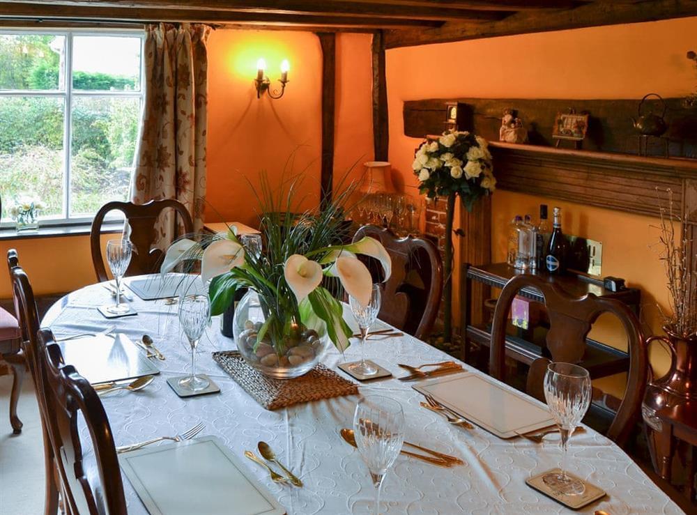 Elegant formal dining room at Tattlepot Farmhouse in Pulham Market, near Diss, Norfolk