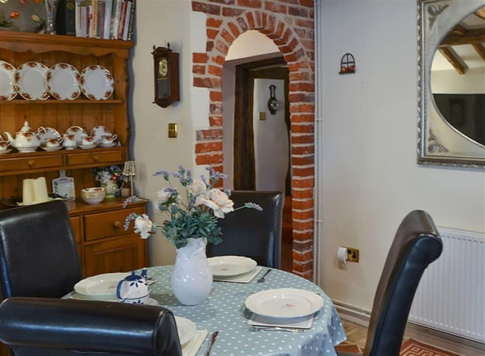 Kitchen dining area with traditional furniture at Tattlepot Farmhouse in Pulham Market, near Diss, Norfolk