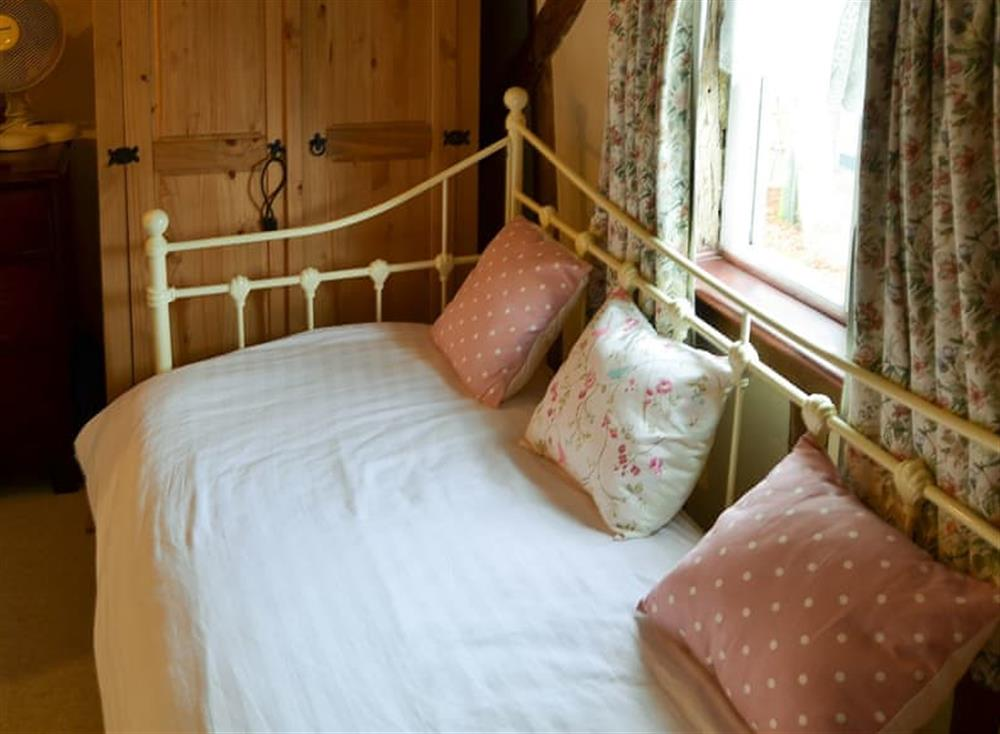 Single/Day bed in the dressing room at Tattlepot Farmhouse in Pulham Market, near Diss, Norfolk