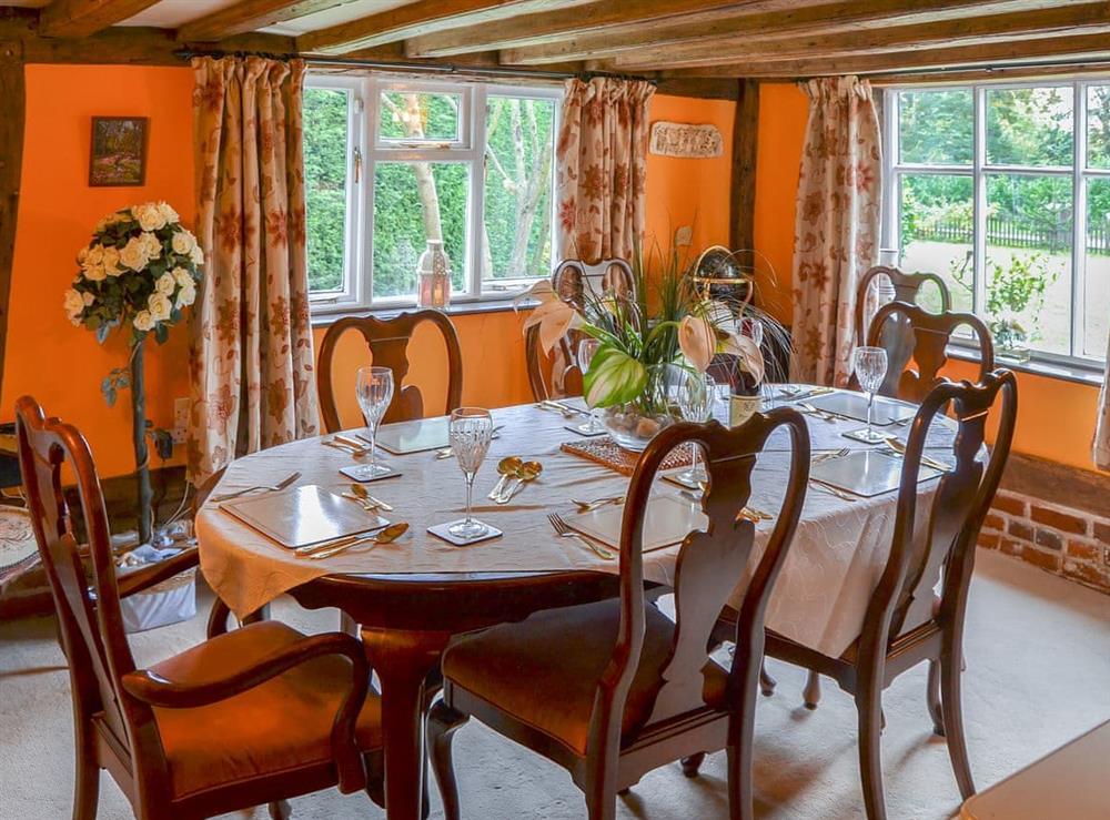 Wonderful dining room with dual aspect windows at Tattlepot Farmhouse in Pulham Market, near Diss, Norfolk