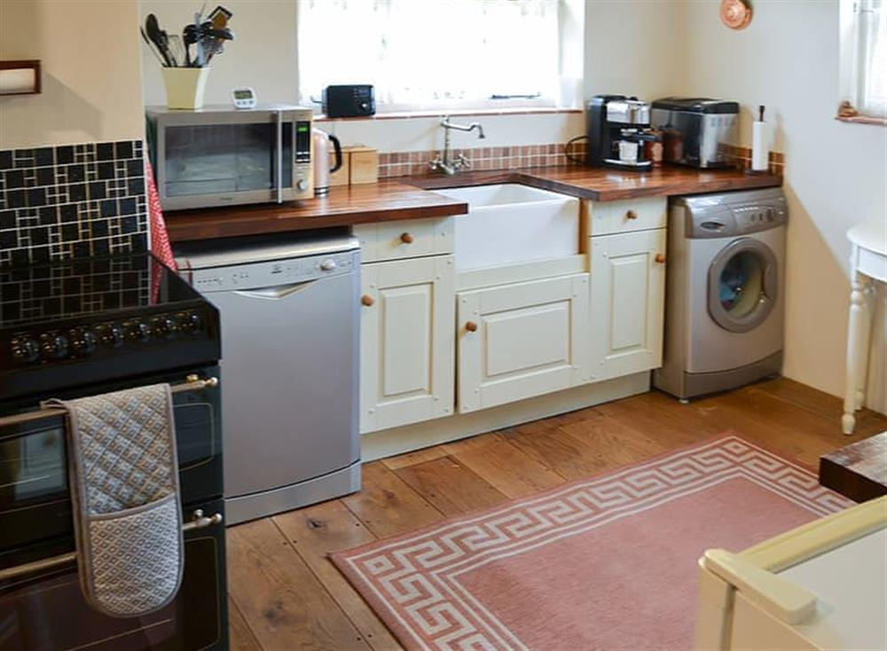 Wood-floored kitchen with all appliances at Tattlepot Farmhouse in Pulham Market, near Diss, Norfolk