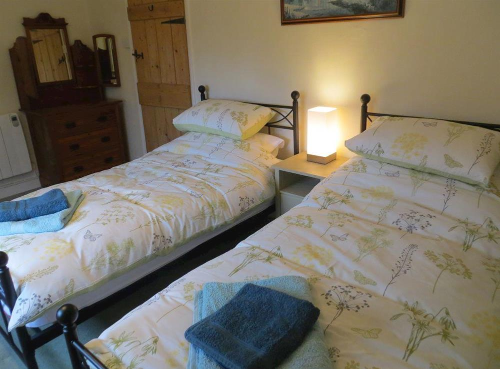 Twin bedroom at Teapot Cottage in Helhoughton, near Fakenham, Norfolk, England