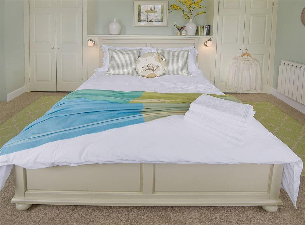 The wide, comfortable bed makes a welcoming place to sleep after a busy day out and about
