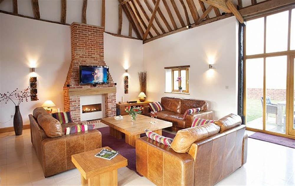 Ground floor:  Spacious vaulted sitting room with dining area leading to open plan kitchen at Thatch Barn, Buringham Green