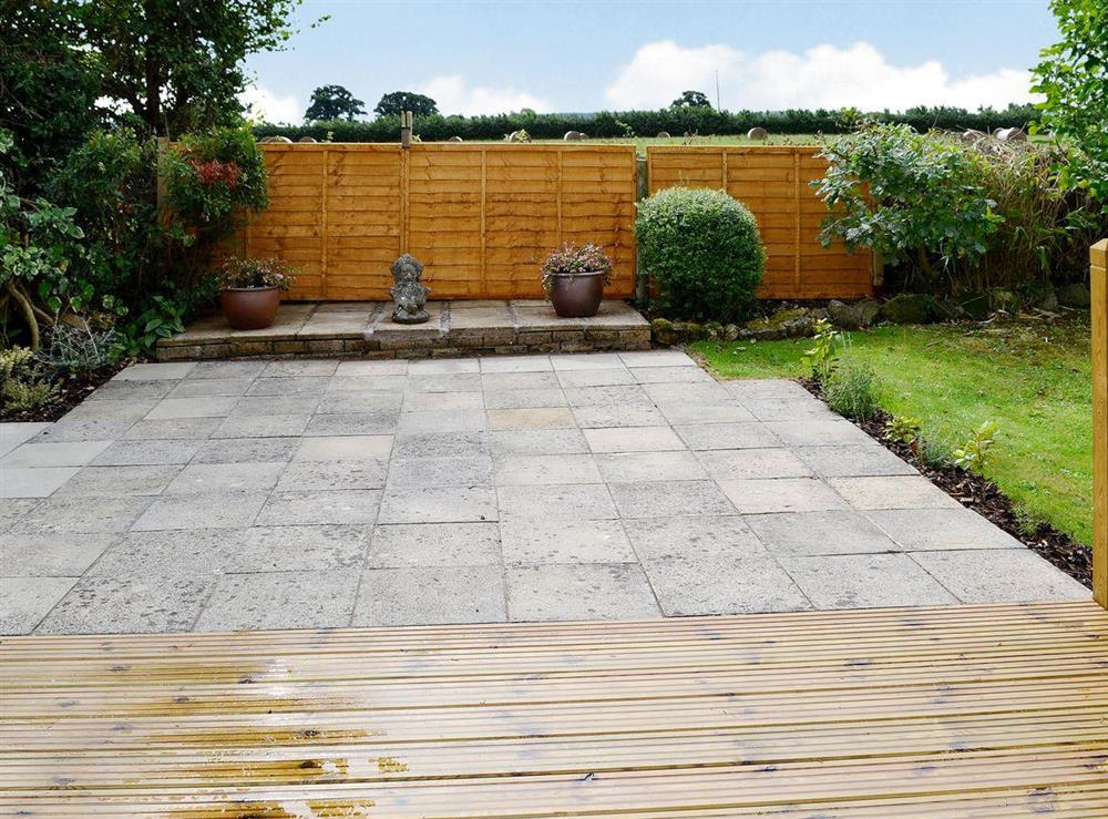 Large paved patio in garden at The Acorns in Moorside, near Sturminster Newton, Dorset