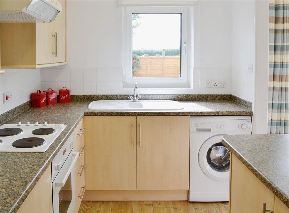 Stylish kitchen with access to garden at The Acorns in Moorside, near Sturminster Newton, Dorset