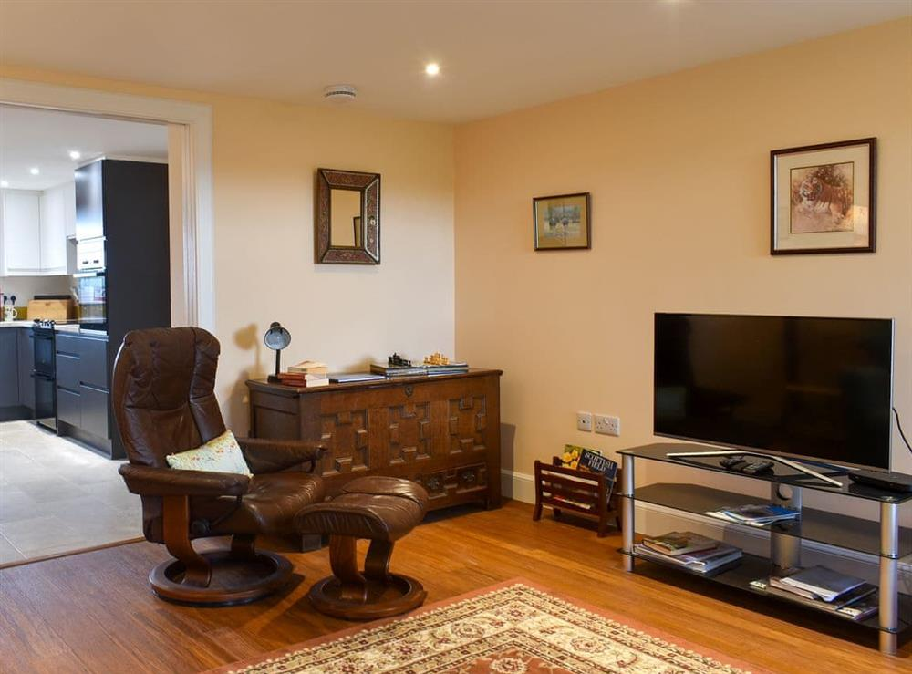 Spacious living room with cosy wood burner at The Annex At Fernyrig in Coldstream, Berwickshire