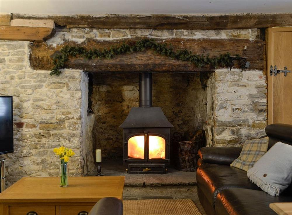 Welcoming living area with wood burner at The Bake House in Bettws, Mid Glamorgan