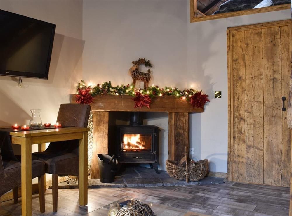 Attractive living area with wood burner at The Barn in Belton, near Great Yarmouth, Norfolk