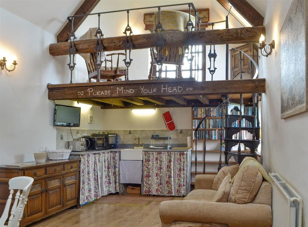 Open plan living space at The Barn in Ton Kenfig, near Bridgend, Mid Glamorgan