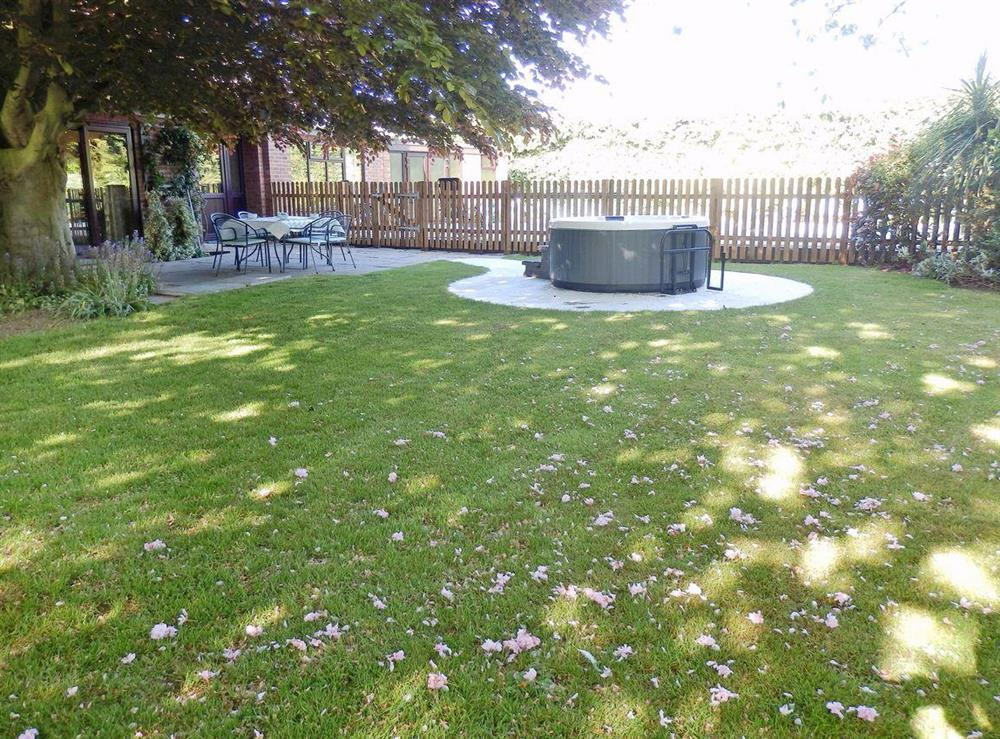 Hot tub and garden at The Beech House in Corton, near Lowestoft, Suffolk