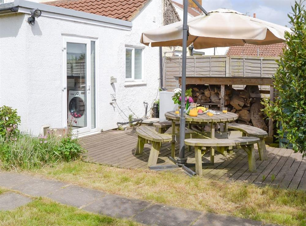 Attractive patio area and log-store at The Boat House in Catfield, near Ludham, Norfolk