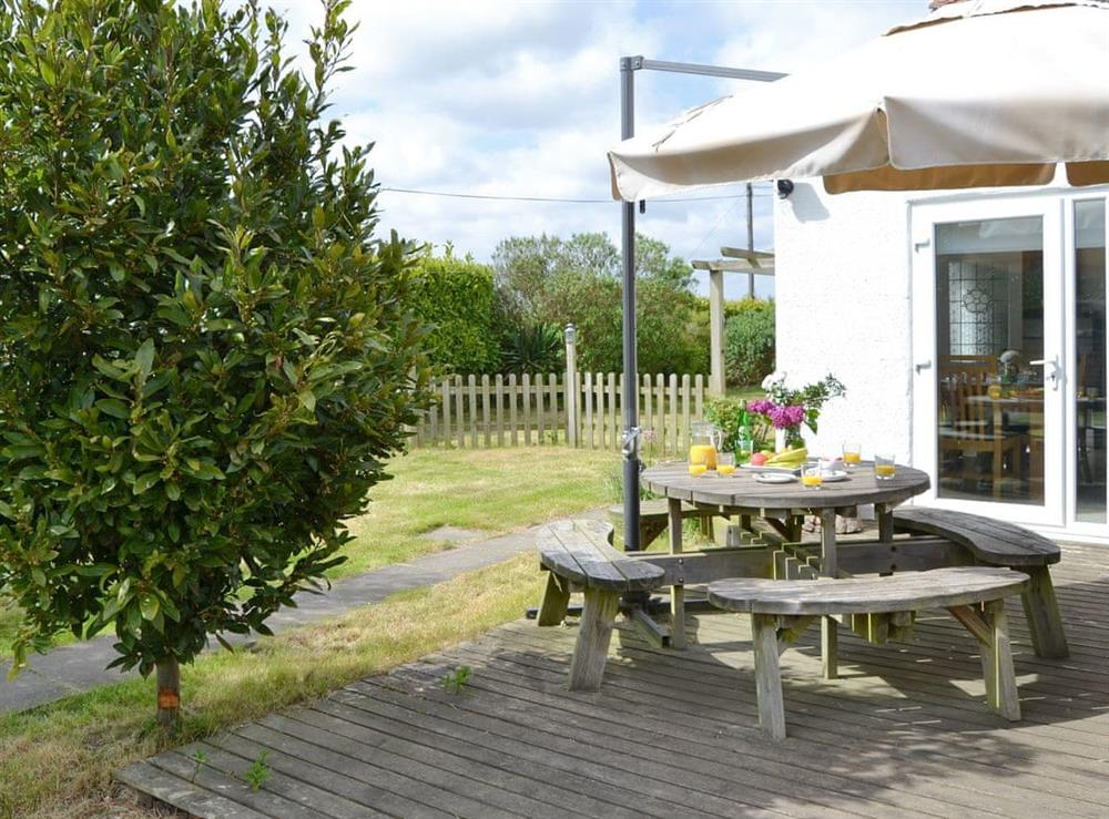 Decked patio area with outdoor furniture at The Boat House in Catfield, near Ludham, Norfolk