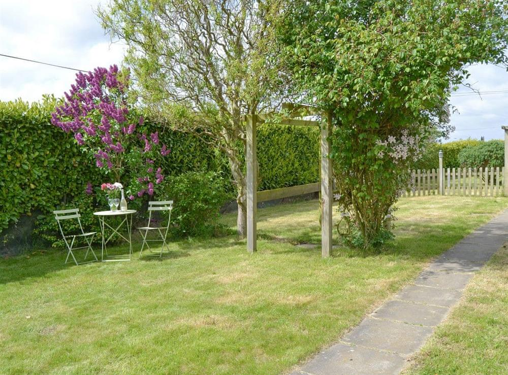 Lawned garden with outdoor furniture at The Boat House in Catfield, near Ludham, Norfolk