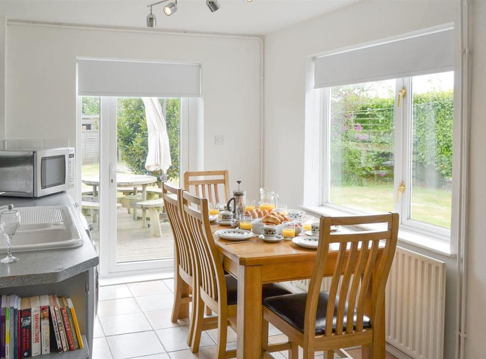 Light and airy dining space within kitchen at The Boat House in Catfield, near Ludham, Norfolk